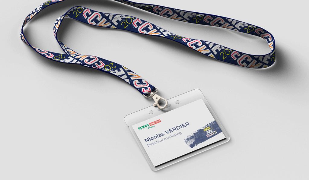 visuel d'un badge événementiel personnalisé avec le logo We Are Eckes, réalisé par Laurent Agier, agence de communication à Toulon
